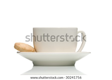 White cup and saucer with a single cookie - stock photo