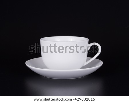 White cup black coffee on black background - stock photo