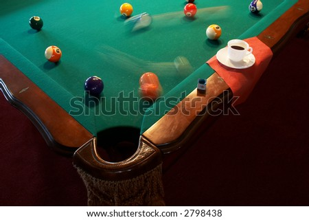 White cup from coffee on a billiard table - stock photo