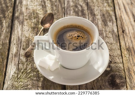White Cup of black coffee on wooden board - stock photo