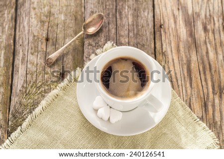 White Cup of black coffee on wooden board