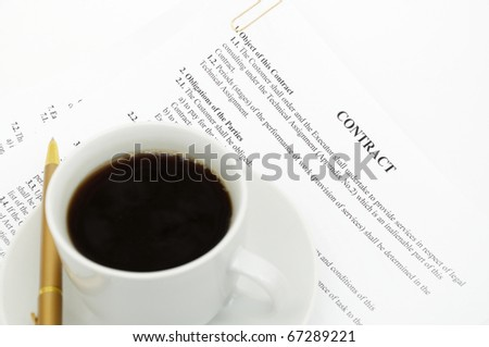 White cup of cappuccino on document background
