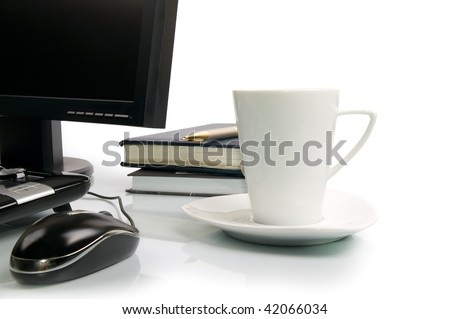 white cup of coffee and computer. - stock photo