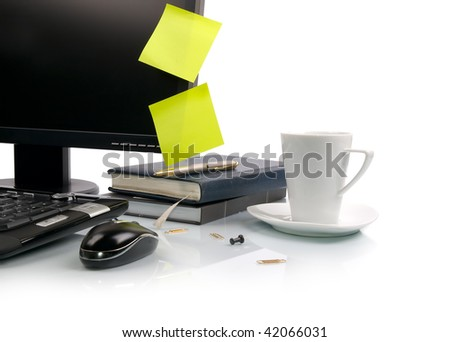 White cup of coffee and computer. Empty sticky notes on monitor. - stock photo