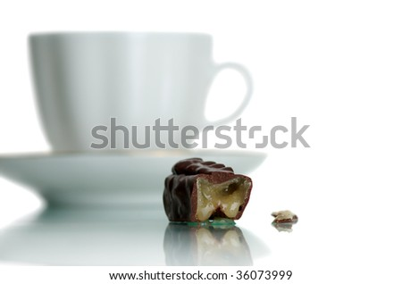 White cup of coffee and sweet on a white background