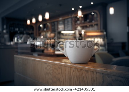 White cup of coffee at the cafe interior