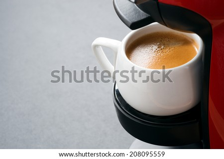 white cup of coffee in the coffee machine and space for text, horizontal - stock photo
