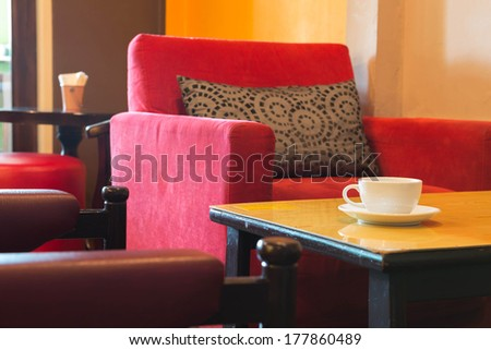 white cup of coffee in wood table at coffee cafe - stock photo