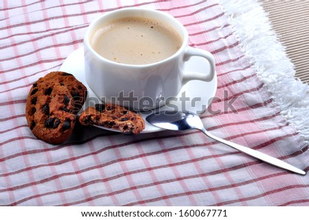 white cup of coffee on saucer with cakes