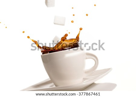 White cup of coffee splash on white background - stock photo