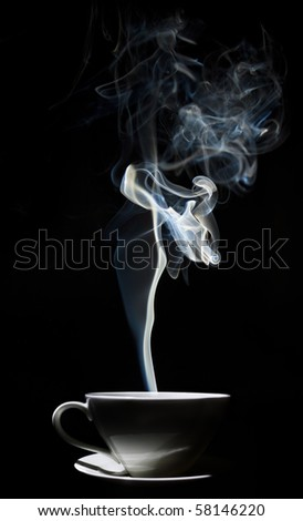 White cup of coffee with a dense smoke in the air, against a black background. - stock photo