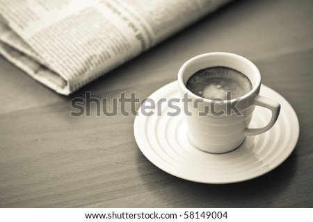 white cup of Espresso with Newspaper, vintage