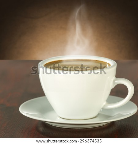 white cup of hot coffee on desk space