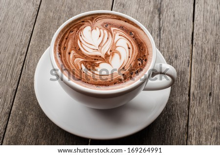 White cup of hot latte coffee - stock photo