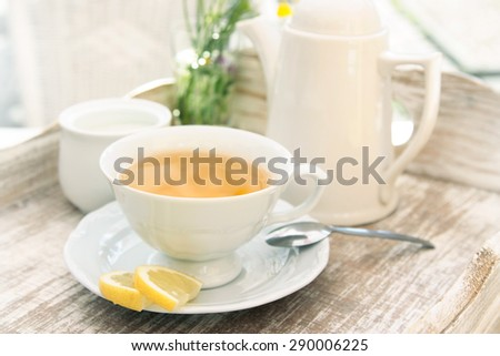 white cup of tea - stock photo