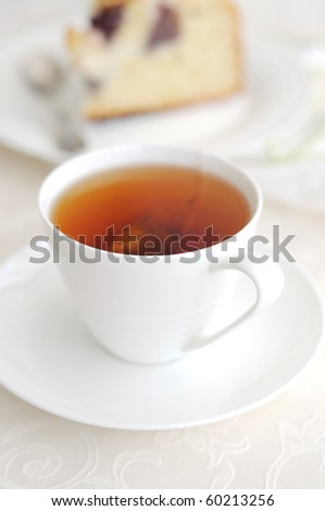 White cup of   tea  and slice of cake - stock photo