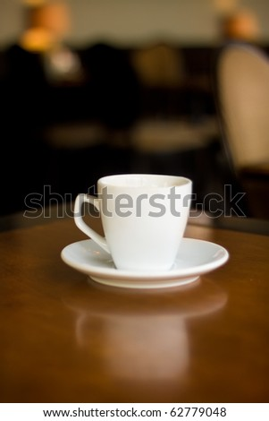 white cup on table in cafe - stock photo