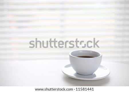 White cup on table/ time for a break/ copyspace - stock photo