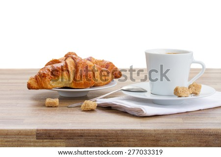 white cup with fresh espresso  coffee and croissant