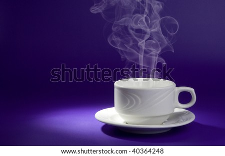 White cup with hot drink on dark blue background