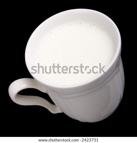 White cup with milk in black background