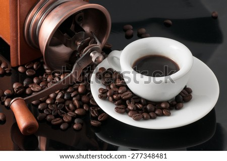 white cup with old Neapolitan grinder coffee - stock photo