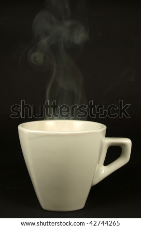 white cup with steaming coffee - stock photo