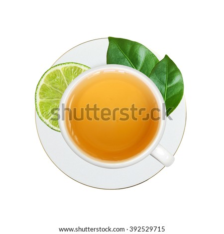 white cup with tea, lime and green leaves isolated on white background
