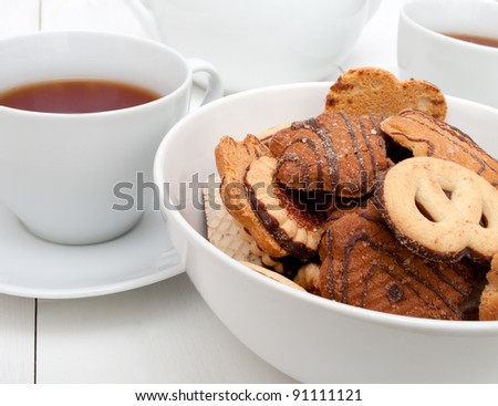 White Cups of Tea and Bowl With Biscuits on White Table