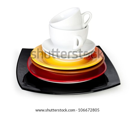 White cups with saucers Isolated on white - stock photo