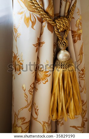 White curtain with an ornament in the modern flat - stock photo