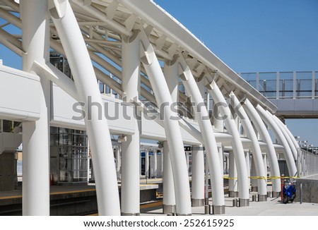 White curved architectural detail against a blue sky