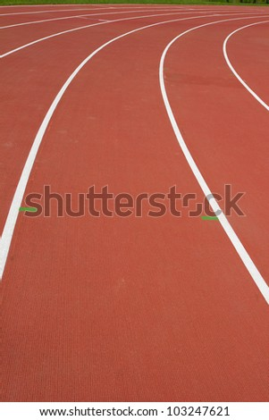 white curved lines of race tracks on stadium - stock photo