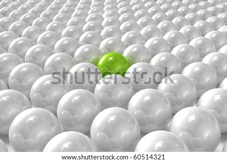 White 3D balls with green one standing out - stock photo
