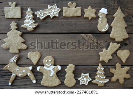 White Decorated Ginger Breads on Wood Building Frame, Background with Copy Space - stock photo