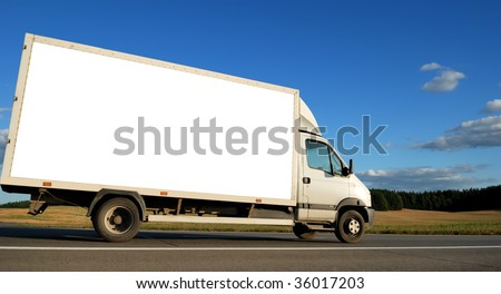 White delivery minitruck moving on the highway over blue sky. - stock photo