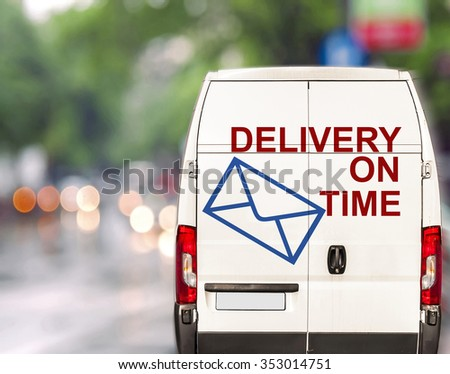White delivery on time Van driving fast on city blurr bokeh street - stock photo