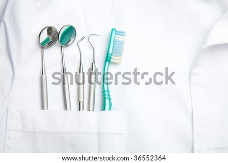 White Dentist Pocket With Toothbrush And Angled Mirror