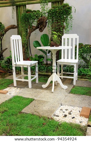 White Desk and chair in the garden - stock photo