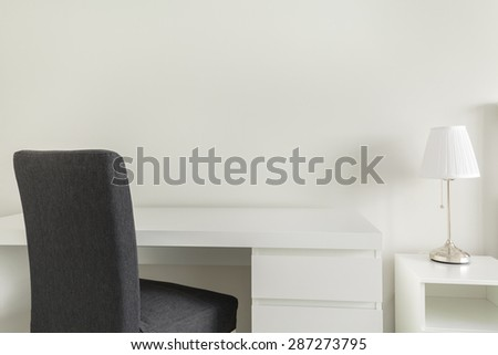 White desk and gray chair in home office - stock photo
