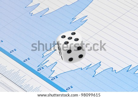 White dice on digital screen with financial chart - stock photo