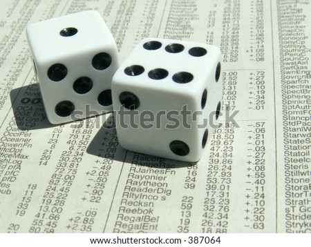 white dice with seven showing on stock section of newspaper.