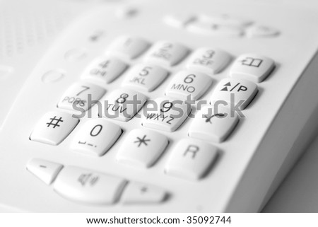 white digital phone keypad with center focus