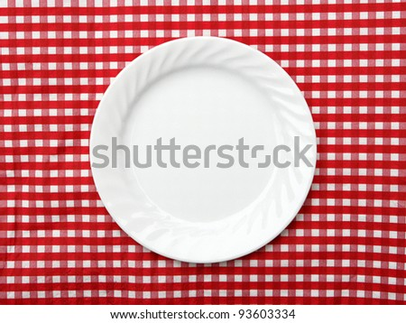 White Dinner Plate on red and white checkered background