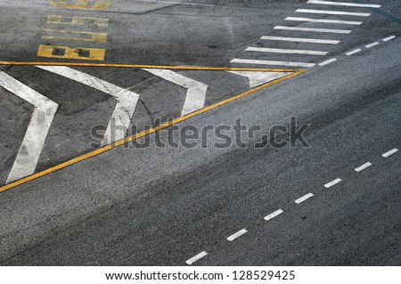 White Directional Arrow on Asphalt - stock photo