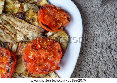 White dish with grilled tomatoes, zucchini and eggplants - stock photo