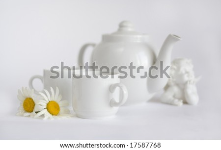 white Dishware with figurine - stock photo