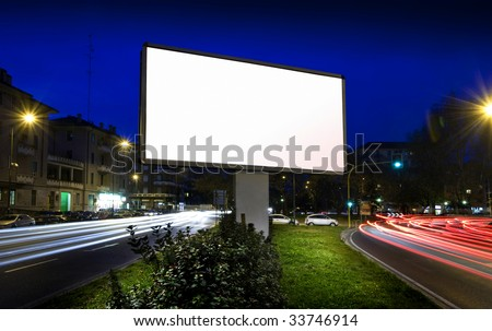 white display advertising with traffic at night - stock photo