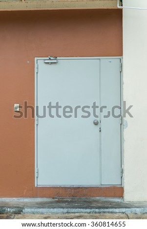 white door on a brown wall