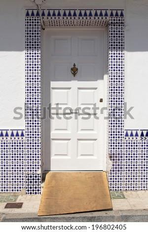 white door with spanish azulejos - stock photo